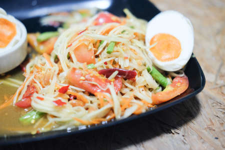 Famous Thai food Papaya salad with salted egg or what we called Somtum Kai-Kem in Thai Language