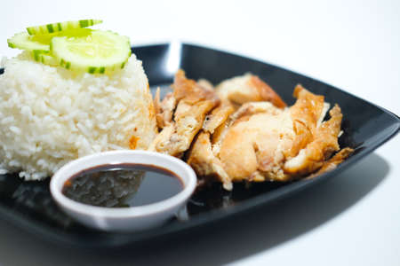 Roast chicken and cooking rice with sweet spicy sauce on a white background