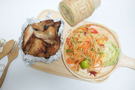 Green papaya salad grilled chicken and sticky rice on white background Stock Photo