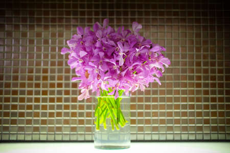 Mokara bouquet in glass pot decoration in room
