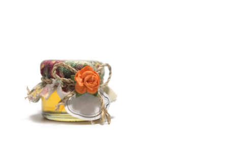 Honey jar wedding souvenir with empty tag on white background