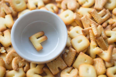 Alphabet biscuit in ceramic cups (Closeup letters F), random letters