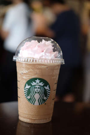 Bangkok, Thailand - April 1, 2017: Cup of Starbucks ice coffee with whipped cream in Starbucks coffee shop