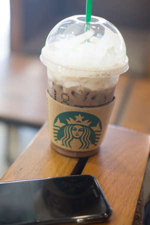 Bangkok, Thailand - Aug 19, 2017: Cup of Starbucks ice coffee with whipped cream in Starbucks coffee shop