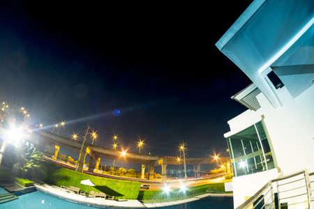 Empty of swimming pool in condominium at night Stock Photo