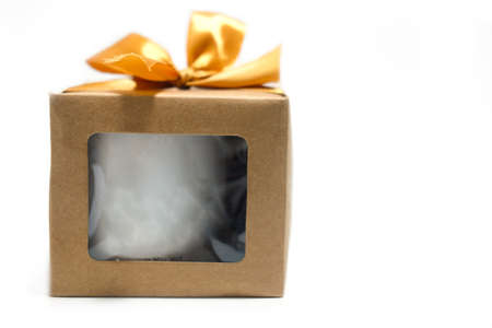 Gift box with gold ribbon on white background