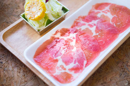 Raw pork sliced for hot pot (Selective focus)
