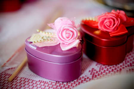 Souvenir gift red and pink stainless box with wedding ceremony background