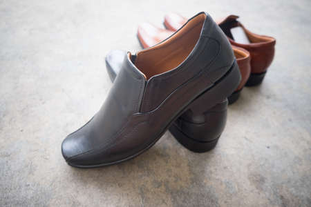 New black shoe on floor cement