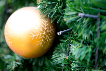 Christmas tree decoration golden ball. Concept of the traditional celebration of New Year