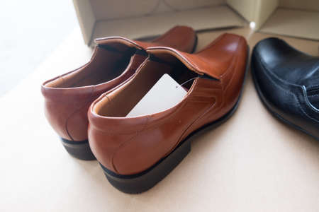 A pair of new mens brown leather shoes
