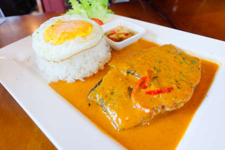 Fish in dried red curry served with egg and rice, Thai food