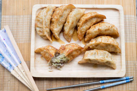 Fried dumplings. Known as gyoza in the Japanese language Stock Photo