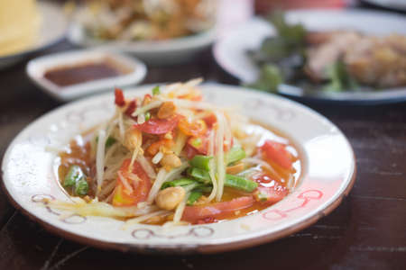 Somtum Thai spicy green papaya salad eat with sticky rice