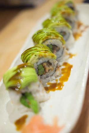 Tasty appetizing uramaki sushi roll (selective focus)