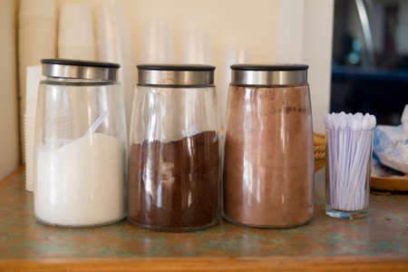 Jar of coffee, sugar and cocoa in buffer at hotel