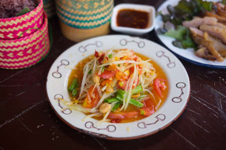Thai gourmet : Healthy of Thai green papaya salad top view or Som Tum. Som Tum is original local food from the Northeast of Thailand 写真素材