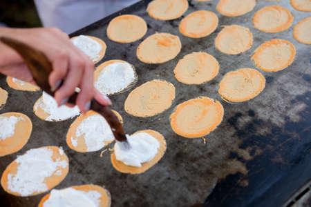 Row of Thai crispy pancakes on hot pan (Thai sweet)