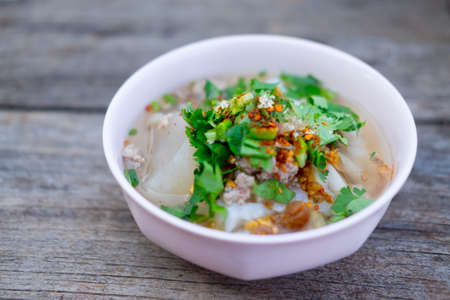 Rice boiled with pork garlic and coriander in pink bowl