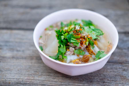 Boiled rice with pork in pink bowl Stock Photo