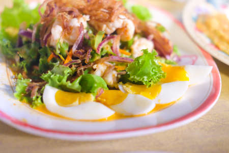 Winged bean salad with shrimp and boiled egg. Thailand called is Yum-Tua-Phuu
