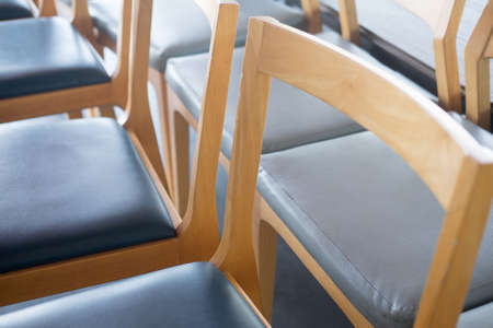Close up view of wooden chairs, many chair