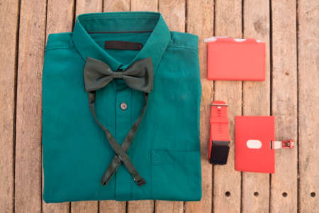 Green shirt and green bow tie for business and recreation, stylish groom