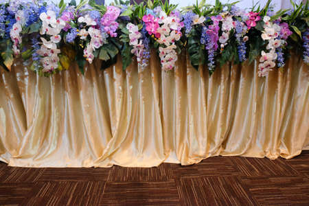 Close up flowers decoration on front stage of conference or meeting room Imagens