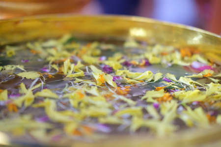 Traditional Thai in Songkran day petal flowers on water in brass bowl