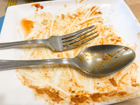 Dirty dish with food scraps and sauce after eat Thai food