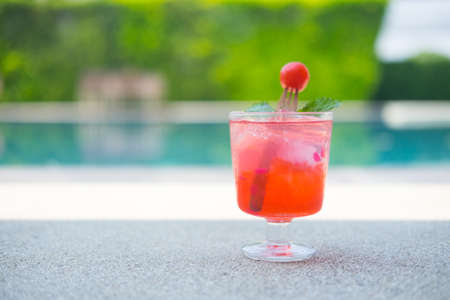 Fresh cherry in sparkling water on swimming pool