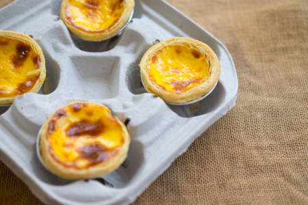 Egg tart custard sweet delicious dessert in paper box