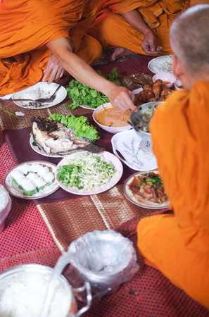 The buddhist monk have breakfast given by people who want to make great merit Banco de Imagens