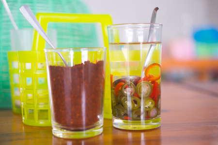 Seasoning Thai food (cayenne pepper, and vinegar) seasoning for the better taste Stock Photo