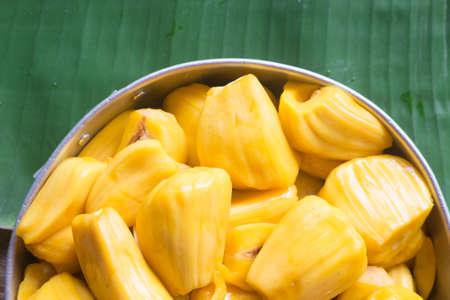 Fresh sweet yellow jackfruit ripe on banana leaf background Stock Photo