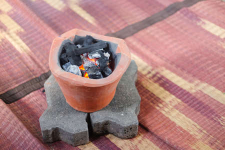 Mini old charcoal stove with charcoal ignited Prepare for cooking Stock Photo - 101271142