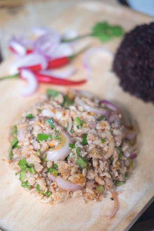 Thai food, spicy minced pork salad on wood plate (Larb Moo) Stock Photo