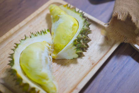 Yellow flesh of Durian fruits served on wooden plate