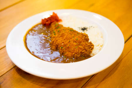 Curry rice with fried pork. Japanese food Tonkatsu curry rice