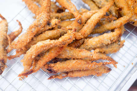 Deep fried Smelt fish with many eggs, Close up Stock Photo