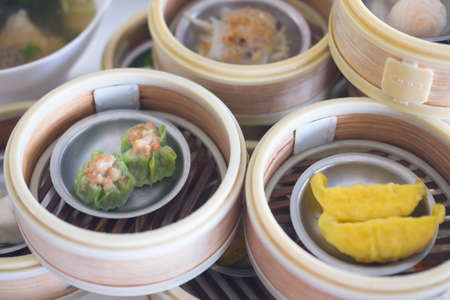 Closeup of various kinds of delicious dim sum, a Chinese traditional food normally eaten for breakfast 스톡 콘텐츠