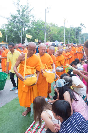 Saraburi, Thailand - July 29, 2018 : Monks walking to receive the flowers from the Buddhisms in Festival of Floral Offerings at Wat Phra Phuttabat temple, Saraburi , Thailand
