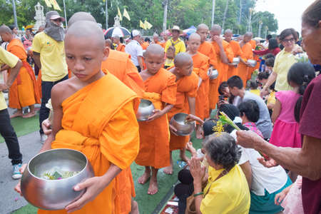 Saraburi, Thailand - July 29, 2018 : Many people give flowers to Buddhist monks for alms in The Tak Bat Dok Mai (give flowers to monk) Ceremony at Phra Buddha Bat Woramahavihan Temple