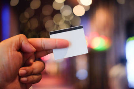 Hand with cinema tickets. Access on entertainment or film