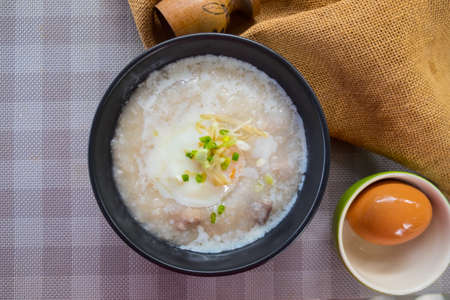 Rice porridge or congee with pork egg sliced ginger and vegetable. Delicious breakfast Stok Fotoğraf