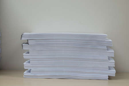Pile of unfinished documents on office desk folders. Business papers or document is written. Business offices concept.