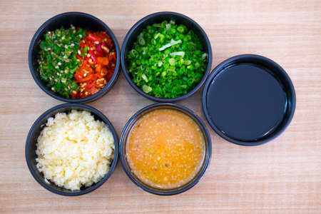 Set of Sauce for Shabu shabu style in black bowl, top view 免版税图像