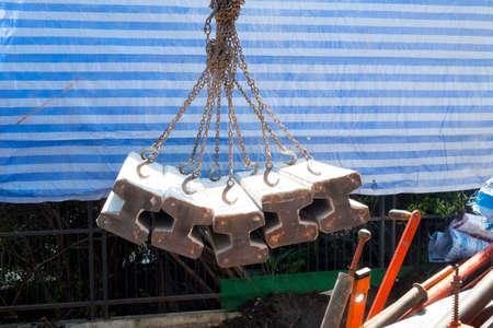 Move concrete foundation piles in construction site. House construction concept