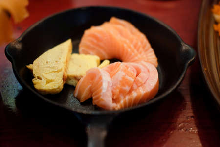 Japanese food delicacy consisting sashimi salmon of very fresh raw salmon fish sliced