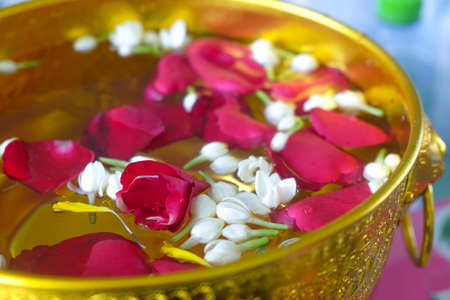 Jasmine and rose leaf in bowl for bless adults Thai traditional for Mother's day or Father's day in Thailand.